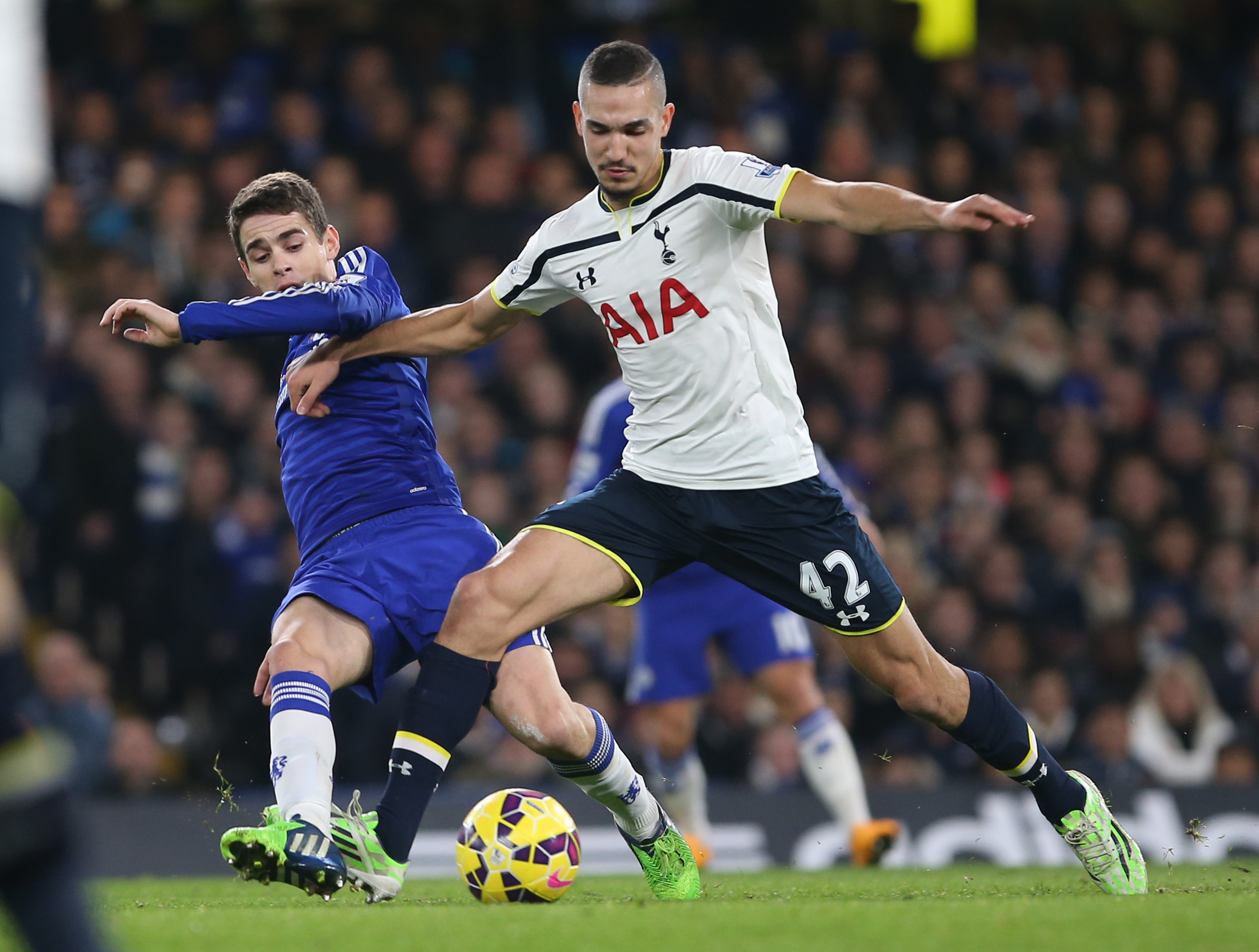 03 December 2014 Premier League Football - Chelsea FC v Tottenham Hotspur; Nabil Bentaleb of Tottenham shields the ball from Oscar. Photo: Mark Leech