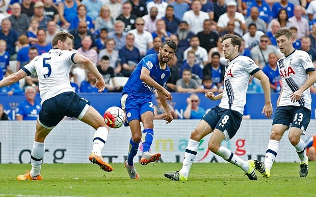 "Football - Leicester City v Tottenham Hotspur - Barclays Premier League - King Power Stadium - 22/8/15  Riyad Mahrez scores the first goal for Leicester  Action Images via Reuters / Carl Recine  Livepic  EDITORIAL USE ONLY. No use with unauthorized audio, video, data, fixture lists, club/league logos or ""live"" services. Online in-match use limited to 45 images, no video emulation. No use in betting, games or single club/league/player publications.  Please contact your account representative for further details."