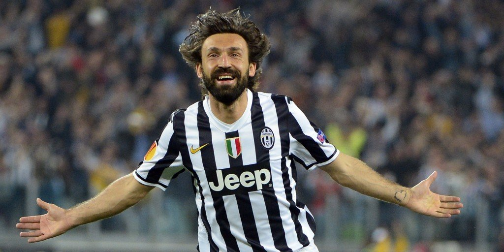 Juventus' midfielder Andrea Pirlo celebrates after scoring during the UEFA Europa League quarter-final football match Juventus vs Olympique Lyonnais, on April 10, 2014 at the Juventus stadium in Turin. AFP PHOTO / OLIVIER MORIN (Photo credit should read OLIVIER MORIN/AFP/Getty Images)