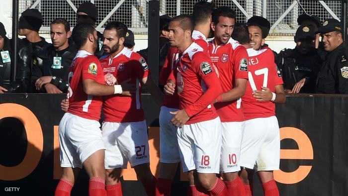 Etoile du Sahel's players congratulate teammate Ammar Jemal after his goal during the second final of the 2015 CAF - Confederation of African Football Cup match between Tunisia's Etoile du Sahel and South Africa's Orlando Pirates at the Sousse Olympic stadium. AFP PHOTO / FETHI BELAID / AFP / FETHI BELAID (Photo credit should read FETHI BELAID/AFP/Getty Images)