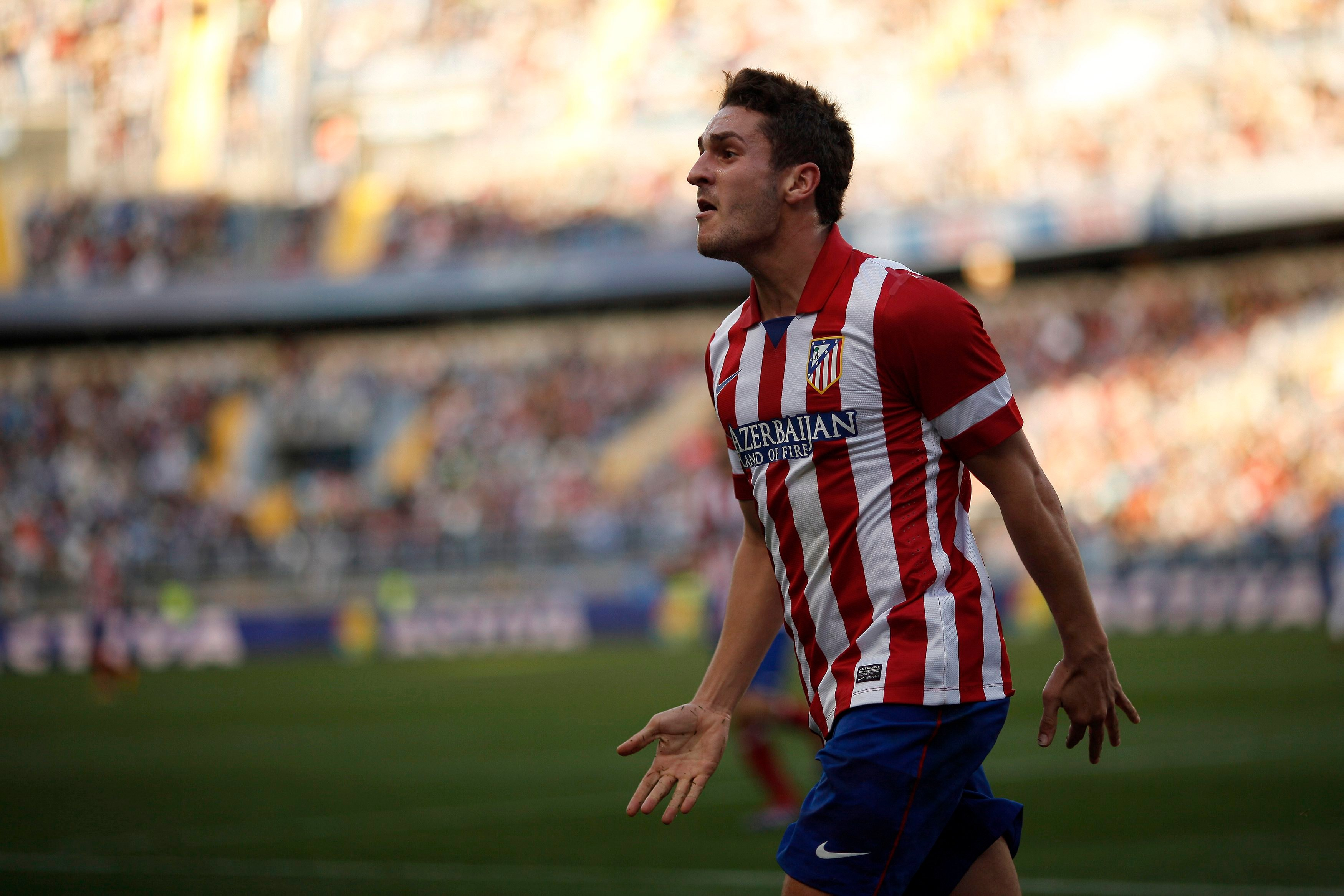 Atletico Madrid's Koke celebrates after scoring a goal against Malaga during their Spanish First Division soccer match at La Rosaleda stadium in Malaga, southern Spain January 4, 2014. REUTERS/Jon Nazca (SPAIN - Tags: SPORT SOCCER)  Picture Supplied by Action Images